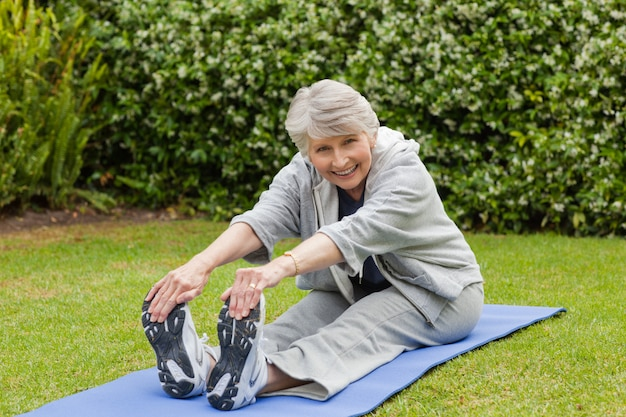 Senior woman doing her streches Premium Photo