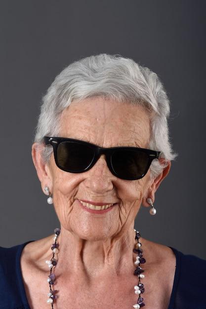Senior woman on grey background Premium Photo