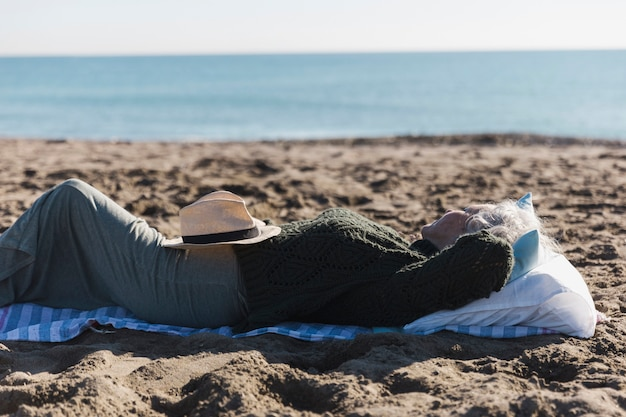 Senior woman relaxing outdoors Free Photo