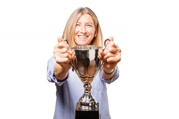 Senior woman smiling with a trophy Free Photo