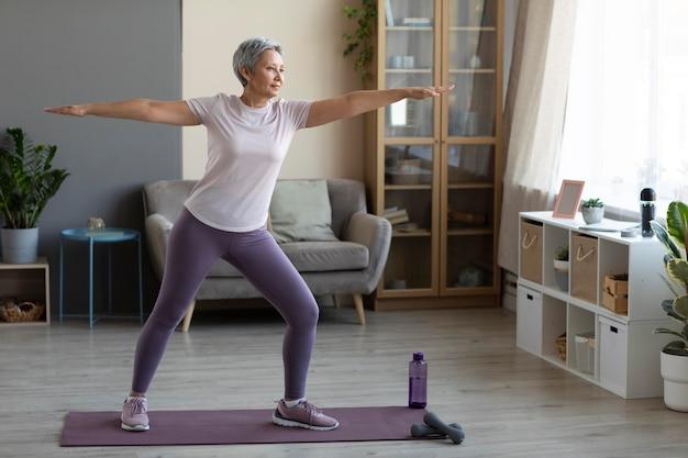 Senior woman training at home Free Photo