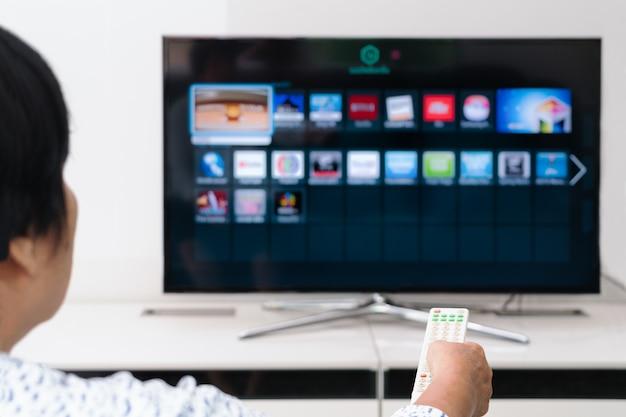 Senior women hand hold remote control of tv box Photo | Premium Download