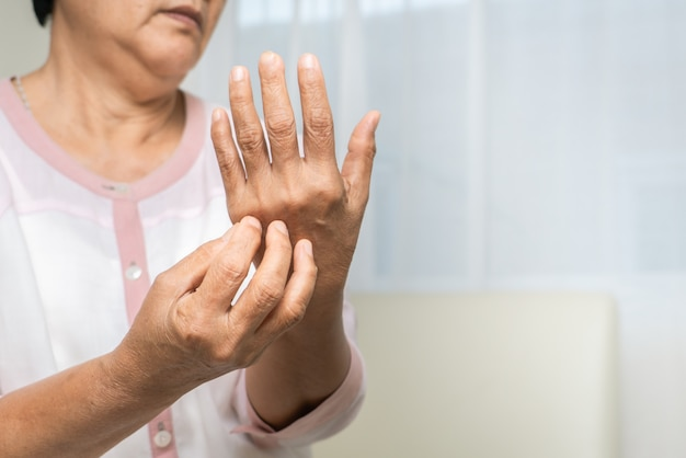 Senior women scratch hand the itch on eczema arm, healthcare and medicine concept Premium Photo