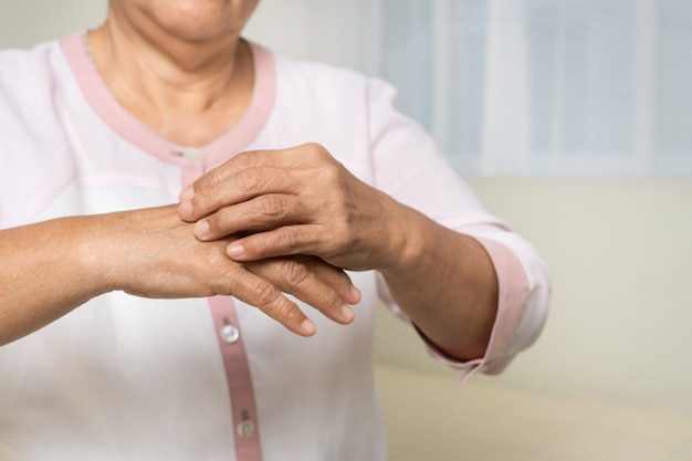Senior women scratch hand the itch on eczema arm, healthcare and medicine concept Premium Photo