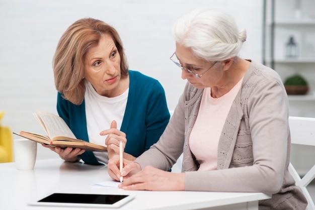 Senior women working together Free Photo
