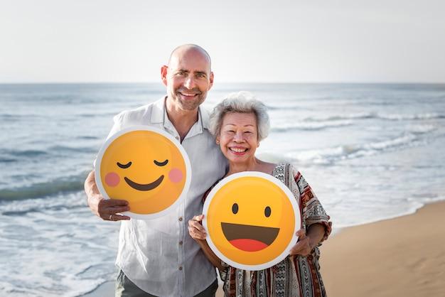 Seniors enjoying a tropical beach Premium Photo