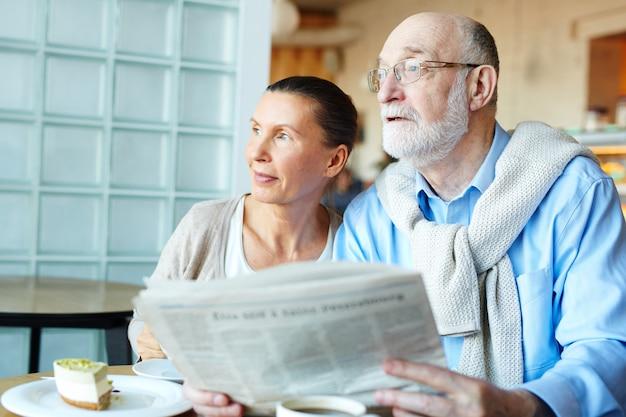 Seniors with newspaper Free Photo