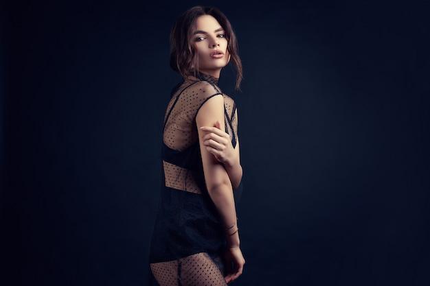 Sensual beautiful brunette woman in a sexy fashion dress Premium Photo
