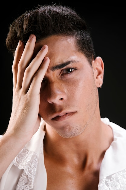 Sensual crying male model in blouse Free Photo