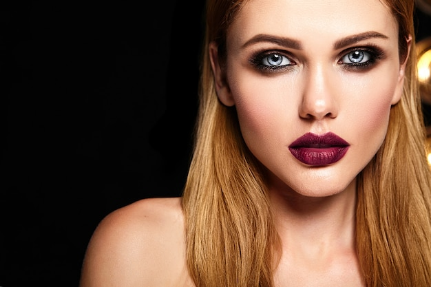 Sensual glamour portrait of beautiful woman model with fresh daily makeup with dark red lips color and clean healthy skin face Free Photo