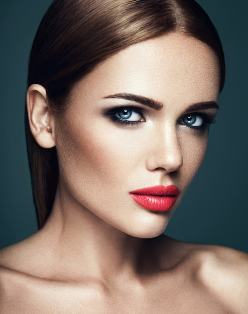 Sensual portrait of beautiful  woman model lady with fresh daily makeup with red lips and clean healthy skin face Free Photo