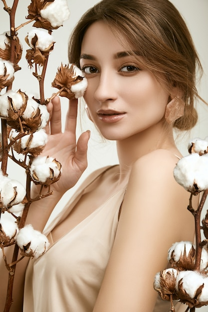 Sensual portrait of glamor woman model among cotton twigs Premium Photo