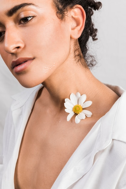 Sensual woman with flower on neck Free Photo
