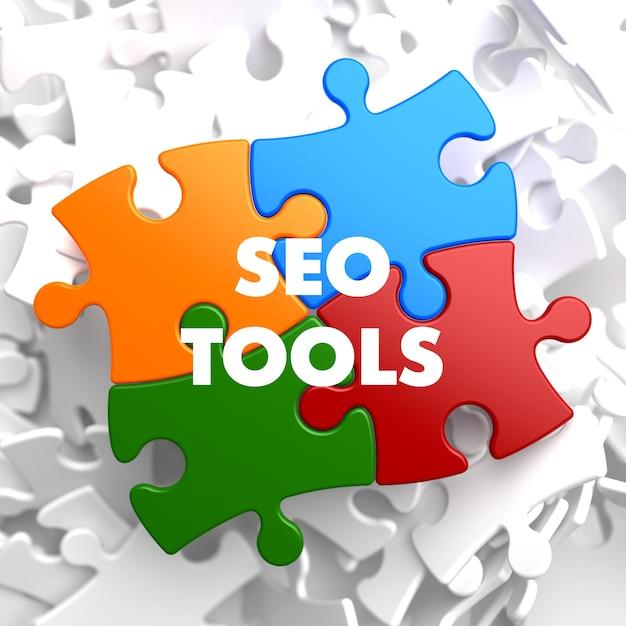 Seo tools on multicolor puzzle. Premium Photo