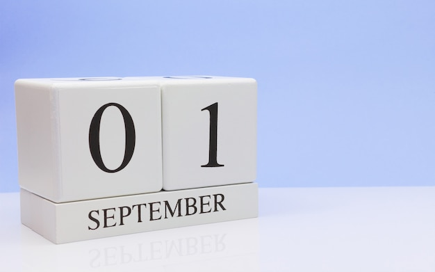 September 01st. day 1 of month, daily calendar on white table with reflection Premium Photo