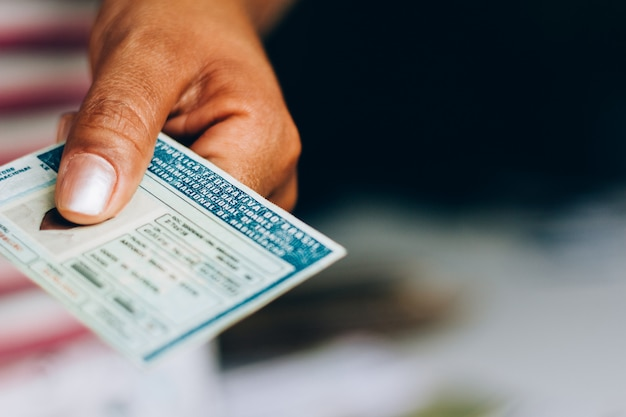 September 10, 2019, brazil. man holds national driver's license (cnh). official document of brazil, which attests the ability of a citizen to drive land vehicles. Premium Photo