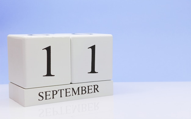 September 11st. day 11 of month, daily calendar on white table with reflection Premium Photo