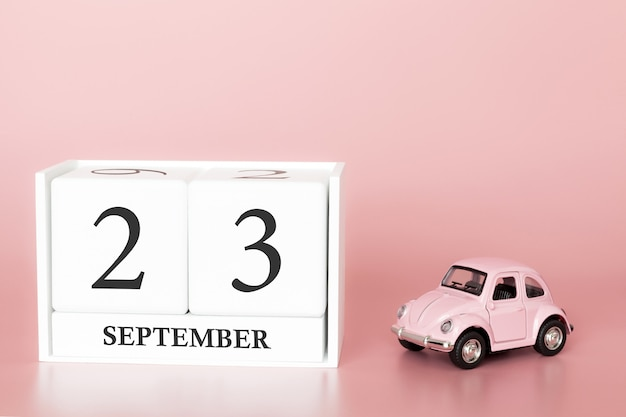 September 23rd. day 23 of month. calendar cube with car Premium Photo