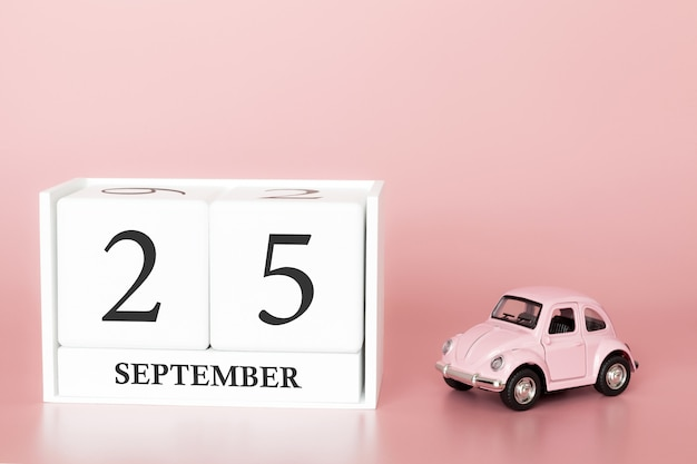 September 25th. day 25 of month. calendar cube with car Premium Photo