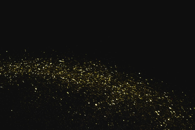 Sequins falling on black background Free Photo