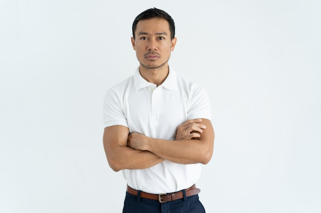 Serious asian businessman in white tshirt looking at camera Free Photo