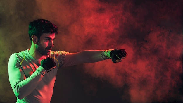Serious boxing man smoke Free Photo