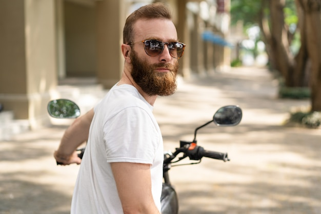 Serious brutal biker ready to ride Free Photo