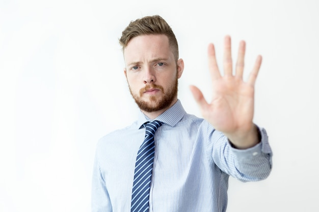 Serious Business Man Showing Stop Gesture Free Photo