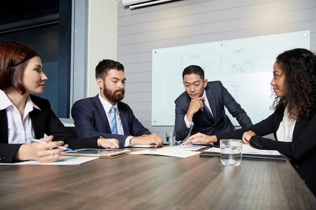 Serious businesspeople having meeting Free Photo