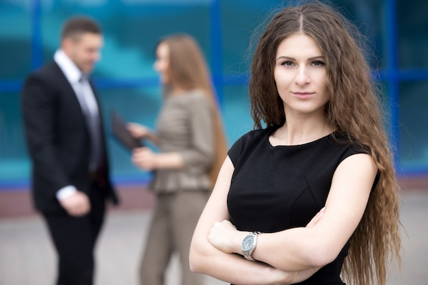Serious businesswoman with long hair Free Photo