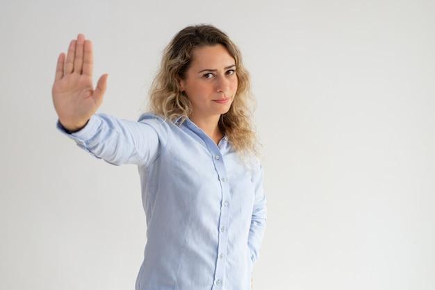 Serious displeased woman making stop gesture Free Photo