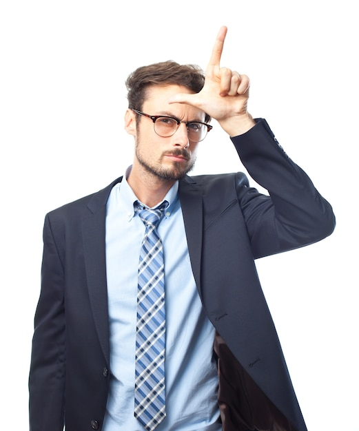 Free Photo | Serious elegant man making the loser gesture
