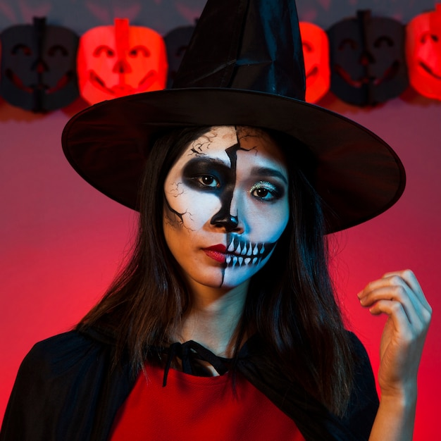 Serious girl in halloween costume Free Photo