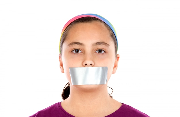 Serious girl with sticking plaster on her mouth Premium Photo