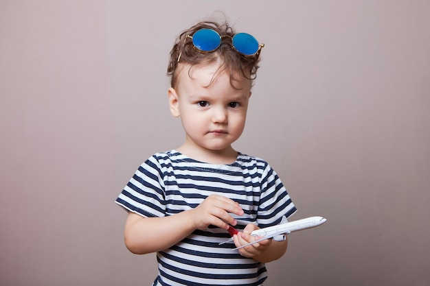 Serious kid with a model aircraft in his hands. Premium Photo