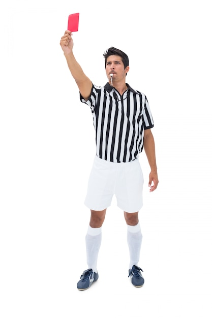 Serious referee showing red card on white background Premium Photo