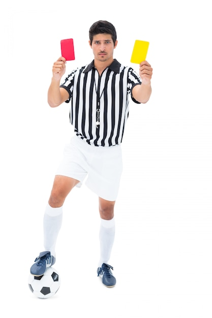 Serious referee showing red and yellow card Premium Photo