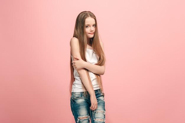 Serious, sad, doubtful, thoughtful teen girl standing at studio. Free Photo