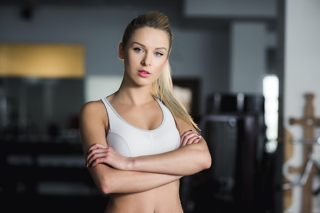Serious sportswoman with crossed arms Free Photo