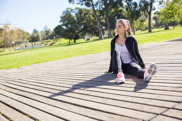 Serious sporty lady relaxing outdoors Free Photo
