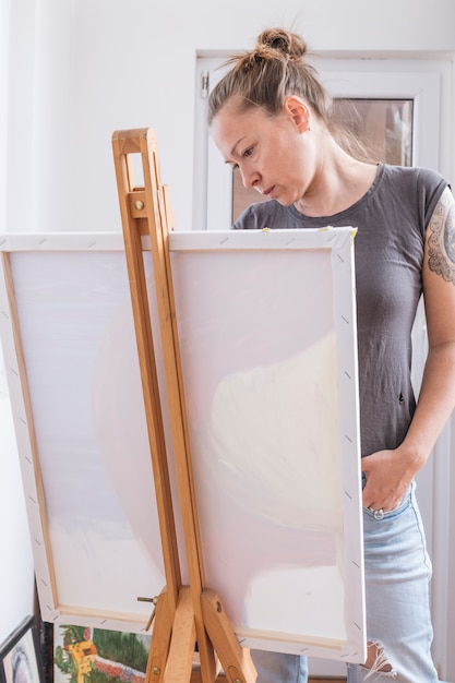 Serious stylish woman looking at picture Free Photo
