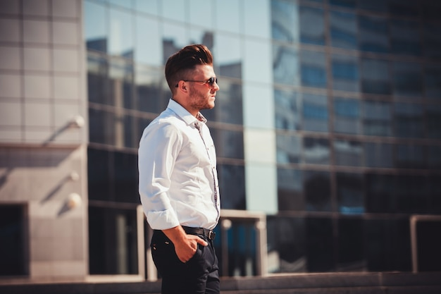 Serious successful man in shirt and glasses Premium Photo