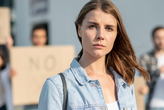Serious woman demonstrating for world peace Free Photo