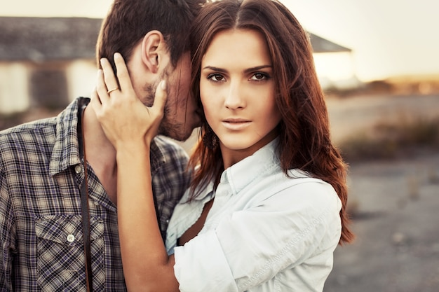 Serious woman with hand on her boyfriend's neck Free Photo