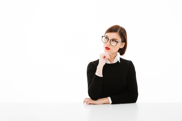 Serious young business lady wearing glasses Free Photo