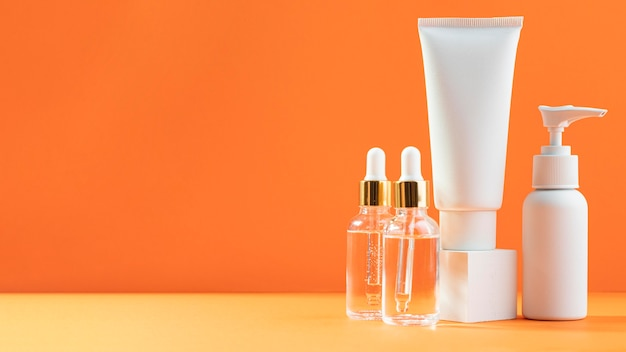 Serum bottles and creme containers Free Photo