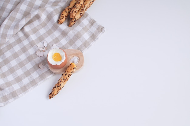 Served breakfast boiled egg in wooden egg cup Premium Photo