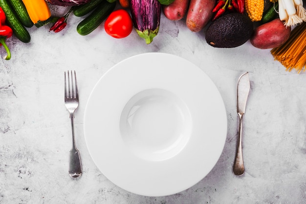 Served empty plate and ripe vegetables Free Photo