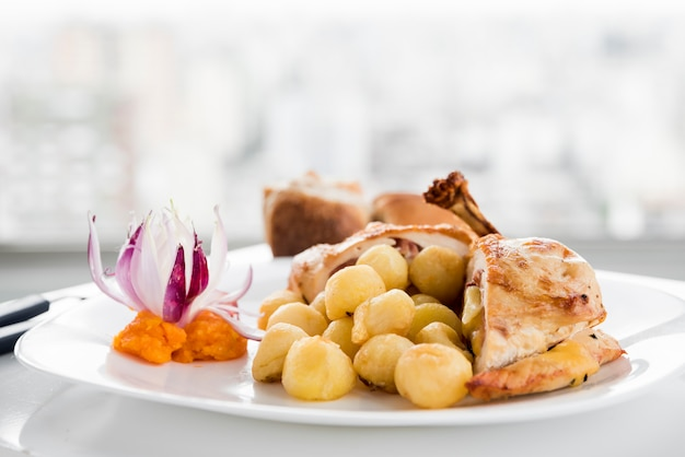 Served plate with chicken breast and gnocchi Free Photo