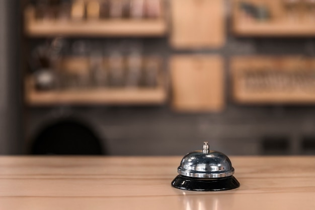 Service bell on wooden counter Premium Photo